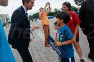 Congressman Beto O`Rourke talking to a kid and his Mother..Photo Niyi Fote