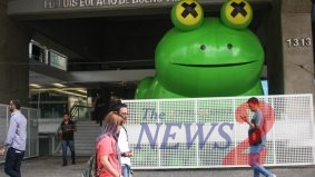 """Enough of Swallowing Frog""in Brazil"