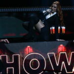 Erikka turns stage into bar and makes a big show during DVD recording